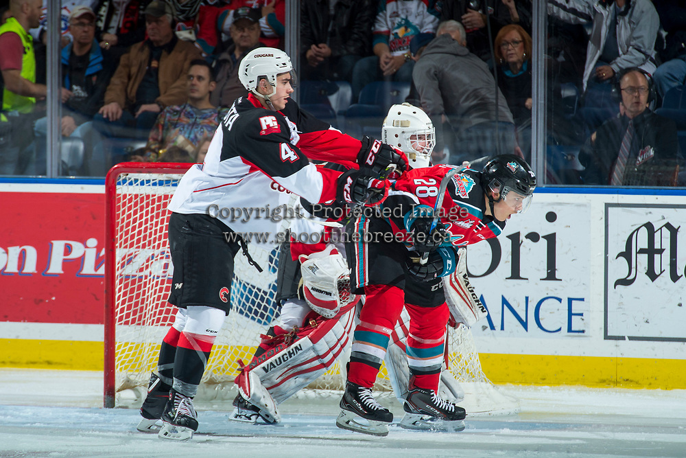 KELOWNA, CANADA - OCTOBER 28: Leif Mattson #28 of the Kelowna Rockets is stick checked by Joel Lakusta #4 of the Prince George Cougars on October 28, 2017 at Prospera Place in Kelowna, British Columbia, Canada.  (Photo by Marissa Baecker/Shoot the Breeze)  *** Local Caption ***