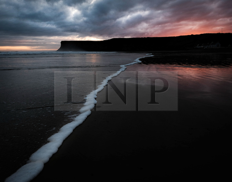 © Licensed to London News Pictures.04/02/16<br /> Saltburn-by-the-Sea, UK. <br /> <br /> Dark clouds gather over the beach at Saltburn by the Sea as the sun begins to rise. The weather is expected to become increasingly windy over the coming weekend.<br /> <br /> Photo credit : Ian Forsyth/LNP