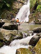 People enjoy cooling off in La Mina Falls, El Yunque Falls, Puerto RIco.