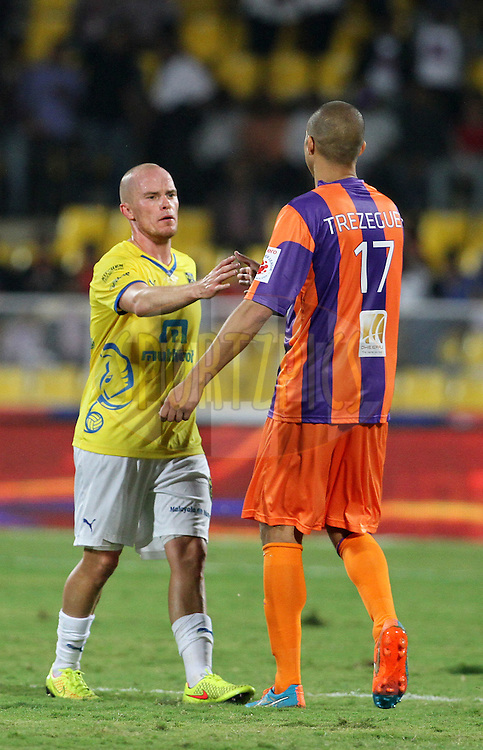 Iain Hume of Kerala Blasters FC shake hands with David Trezeguet of FC Pune City after the match 17 of the Hero Indian Super League between FC Pune City and Kerala Blasters FC held at the Shree Shiv Chhatrapati Sports Complex Stadium, Pune, India on the 30th October 2014.<br /> <br /> Photo by:  Vipin Pawar/ ISL/ SPORTZPICS