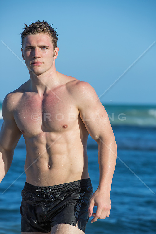 All American man without a shirt at the ocean