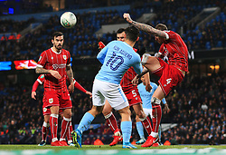 Aden Flint of Bristol City clears under pressure from Sergio Aguero of Manchester City - Mandatory by-line: Matt McNulty/JMP - 09/01/2018 - FOOTBALL - Etihad Stadium - Manchester, England - Manchester City v Bristol City - Carabao Cup Semi-Final First Leg