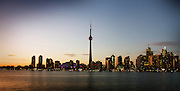Toronto (Canada) cityscape at dusk, facing north, as seen from Centre Island with Lake Ontario in the foreground.