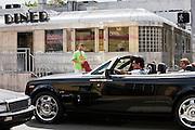 Rolls Royce Phantom Drophead Coupe passing Eleventh Street Diner 1950s railroad car, South Beach, Miami, USA