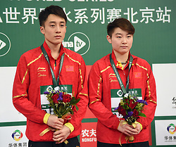 BEIJING, March 9, 2019  Lian Junjie (L) and Si Yajie of China react during the awarding ceremony for mixed 10m synchronised at the FINA Diving World Series 2019 at the National Aquatics Center in Beijing, capital of China, March 9, 2019. (Credit Image: © Xinhua via ZUMA Wire)