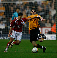 Photo: Steve Bond/Sportsbeat Images.<br /> Wolverhampton Wanderers v Bristol City. Coca Cola Championship. 03/11/2007. Jamie McAllister (L) about to be tackled by Stephen Ward (R)