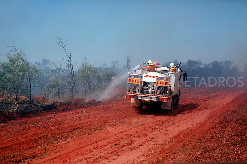 A lone fire truck wets the outskirts of the bush, basically it was imposible to stop a fire this large with just one truck!The Northern part in the Kimberley in Western Australia is very dry and the only time there's rain is in 'the wet' the wet season is from December till March This is in Broome on the way to the dampier peninsula where many fantastic camping spots are and a famous area for fishing as well. It attracts tourists from all over the worls and backpackers love camping 'bush', This very large fire started when some un experienced backpackers lit a fire for cooking and a bit of wind was only needed to create this huge bushfire. This happens occasionally in The Kimberley, which is one of the last remote places in the world. WA-Western Australia.<br /> Exclusive at Getty Images.<br /> http://www.gettyimages.com.au/Search/Search.aspx?contractUrl=2&amp;language=en-US&amp;assetType=image&amp;p=ingetje+tadros<br /> &copy;Ingetje Tadros