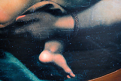 UK ENGLAND LONDON 5MAY12 - Detail comparison of the De Brecy Tondo and Rafael's Sistine Madonna artwork on display at the Westminster Cathedral in central London...The Tondo displays striking resemblance to Rafael's Sistine Madonna, finished as a commissioned altarpiece and the last painting he completed with his own hands a few years before his death...Relocated to Dresden from 1754, the well-known painting has been particularly influential in Germany...jre/Photo by Jiri Rezac....© Jiri Rezac 2012