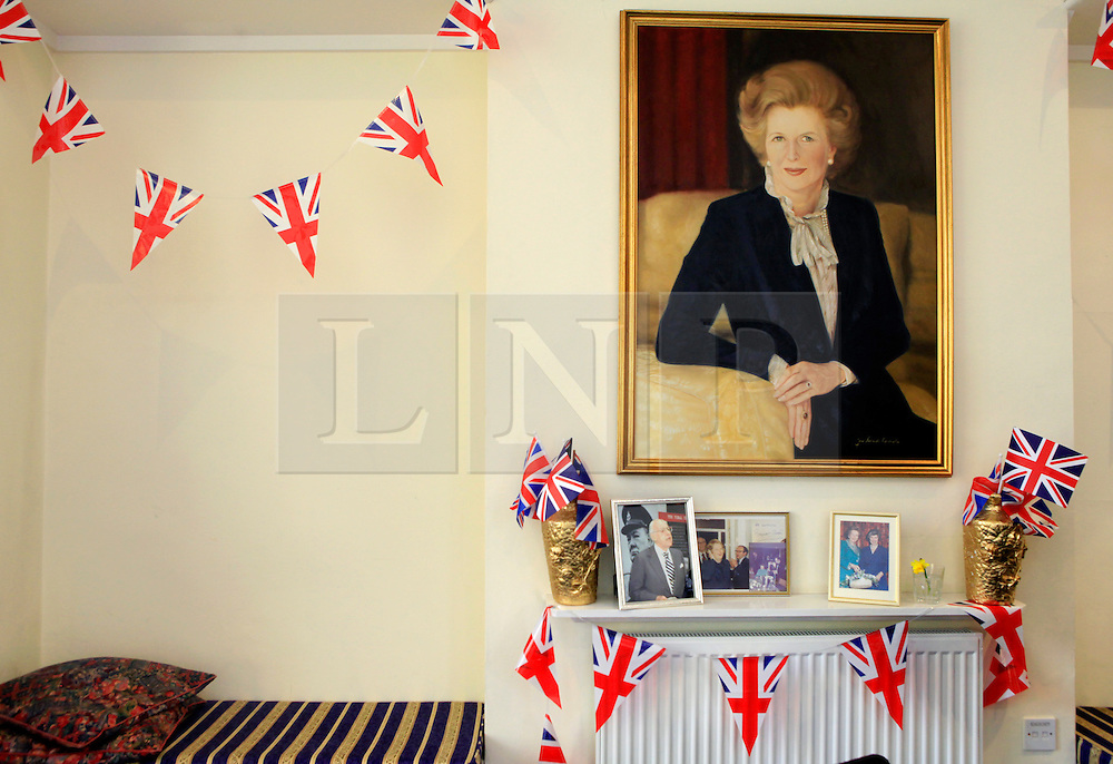 © Licensed to London News Pictures 10/04/2013.A portrait of the late Margaret Thatcher and bunting hangs on the wall above the condolence book, set up at Finchley Conservatives Association in north London..London, UK.Photo credit: Anna Branthwaite