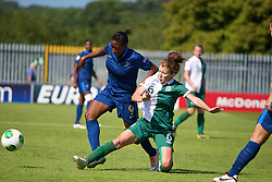 HAVERFORDWEST, WALES - Sunday, August 25, 2013: Wales' Angharad James in action against France's Aminata Diallo during the Group A match of the UEFA Women's Under-19 Championship Wales 2013 tournament at the Bridge Meadow Stadium. (Pic by David Rawcliffe/Propaganda)