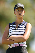 March 28, 2004; Rancho Mirage, CA, USA;  14 year old amateur Michelle Wie waits her turn during the final round of the LPGA Kraft Nabisco golf tournament held at Mission Hills Country Club.  Wie finished the day with a 1 under par 71.  Her overall score of 7 under par 281 was low enough to win low amateur honors and 4th place overall.<br />Mandatory Credit: Photo by Darrell Miho <br />&copy; Copyright Darrell Miho