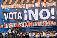 People take part in a campaign rally against Venezuelan President Hugo Chavez's proposal of constitutional changes in Caracas, February 7, 2009. Venezuelans will vote on February 15 on proposed changes to the constitution allowing Chavez and other politicians to stay in office as long as they keep winning elections. (Photo/Ivan Gonzalez)