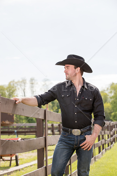 rugged good looking cowboy outdoors hot muscular cowboy on a ranch