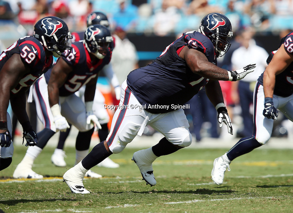 Houston Texans nose tackle Vince Wilfork (75) rushes during the 2015 NFL week 2 regular season football game against the Carolina Panthers on Sunday, Sept. 20, 2015 in Charlotte, N.C. The Panthers won the game 24-17. (©Paul Anthony Spinelli)