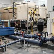 The water treatment plant at the water treatment plant at the Ochiichagwe'Babigo'Ining Ojibway Nation reserve (also known as the Dalles First Nation) in Northern Ontario, Canada on 14 December 2016. The plant draws is its water from the Winnipeg River, and according to operator Aaron Henry, must remove carcinogens resulting from industrial pollution from the water in addition to other contaminants. The Dalles water plant was only built in 2007, and many First Nations communities continue to have inadequate access to safe water. As part of the Trudeau government's commitment to address this situation, the Dalles water plant will participate in a pilot project that will allow many of the plant's operational and water quality parameters to be monitored in real time by operators at a central hub at the Bimose Tribal Council in Kenora, Ontario, about twenty kilometres from the reserve, via an Internet link. Work to provide a dedicated connection to the water plant via an existing tower established by Chad Henry, a resident of the community, is underway.