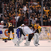 Feb 9, 2011; Boston, MA, USA; Boston Bruins goaltender Tim Thomas (30) makes a save on a shot by Montreal Canadiens forward Brian Gionta (21) during the first period at TD Garden. Mandatory Credit: Michael Ivins-US PRESSWIRE