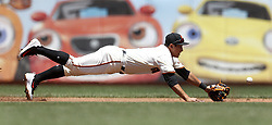 June 28, 2017 - San Francisco, CA, USA - San Francisco Giants third baseman Jae-Gyun Hwang dives for a ground ball during the third inning against the Colorado Rockies on Wednesday, June 28, 2017, at AT&T Park in San Francisco. The Giants won, 5-3. (Credit Image: © Aric Crabb/TNS via ZUMA Wire)