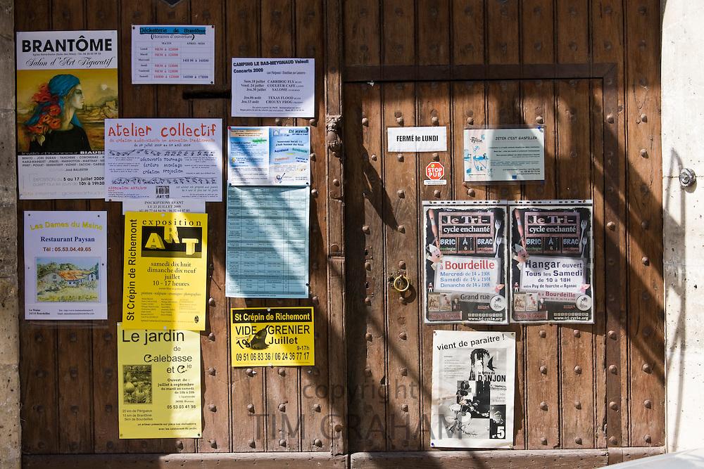 Posters in quaint town of Bourdeilles popular tourist destination near Brantome in Northern Dordogne, France