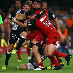 DURBAN, SOUTH AFRICA - MARCH 26: Joe Pietersen tackled by Ryan Crotty of the BNZ Crusaders and Kieron Fonotia of the BNZ Crusaders during the Super Rugby match between Cell C Sharks and BNZ Crusaders at Growthpoint Kings Park on March 26, 2016 in Durban, South Africa. (Photo by Steve Haag)<br /> <br /> images for social media must have consent from Steve Haag