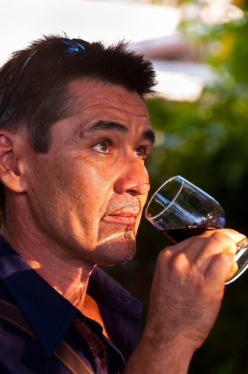 Francois Tran sampling French wines, La Maison Ballande (French wine merchant), Noumea, New Caledonia