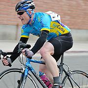 Rider cornering in the 2011 UA Criterium bicycle race, Tucson, Arizona. Bike-tography by Martha Retallick.