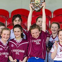 Lisdoon captain Tara Connolly raises the Division 3 shield<br /> <br /> <br /> Lisdoonvarna Parish Schools v Scoil Réalt na Mara, Kilkee/Moyasta NS, in Division 3  Clare Primary Schools Ladies Football Finals at Cusack Park, Ennis, Co. Clare