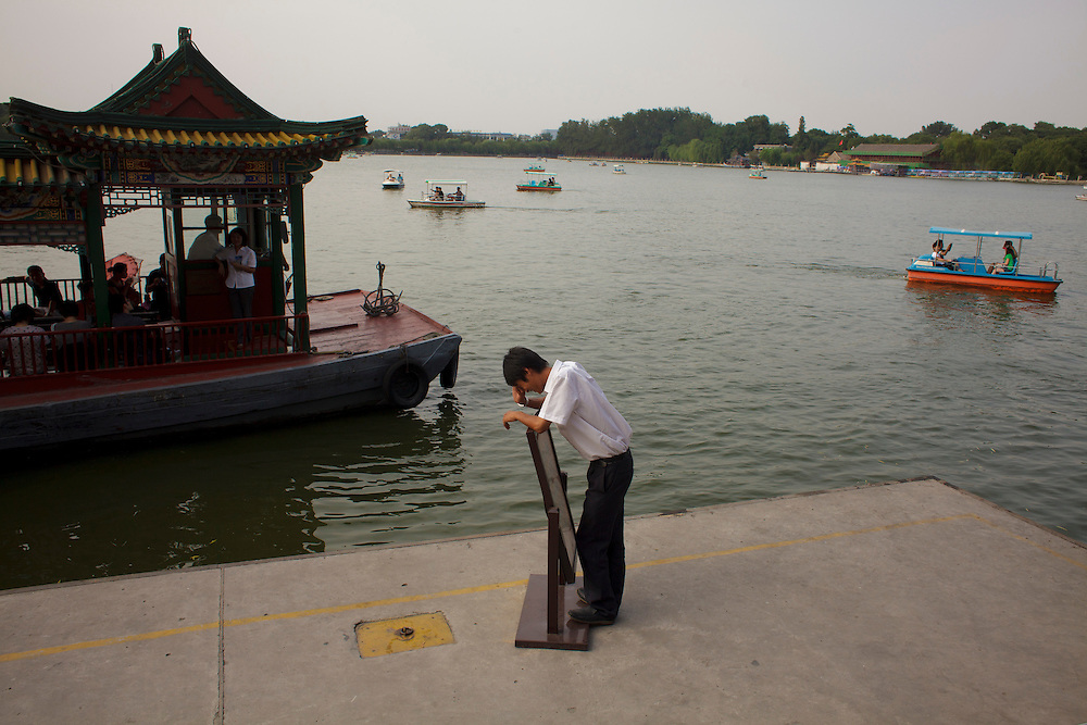 A boat man laughs near the dock at Behai Park in Beijing.