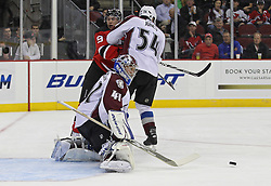 Oct 15; Newark, NJ, USA; Colorado Avalanche goalie Craig Anderson (41) makes a save while Colorado Avalanche right wing David Jones (54) defends against New Jersey Devils left wing Zach Parise (9) during the second period at the Prudential Center.
