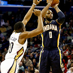 Dec 15, 2016; New Orleans, LA, USA; Indiana Pacers forward C.J. Miles (0) shoots over New Orleans Pelicans guard Langston Galloway (10) during the second quarter of a game at the Smoothie King Center. Mandatory Credit: Derick E. Hingle-USA TODAY Sports