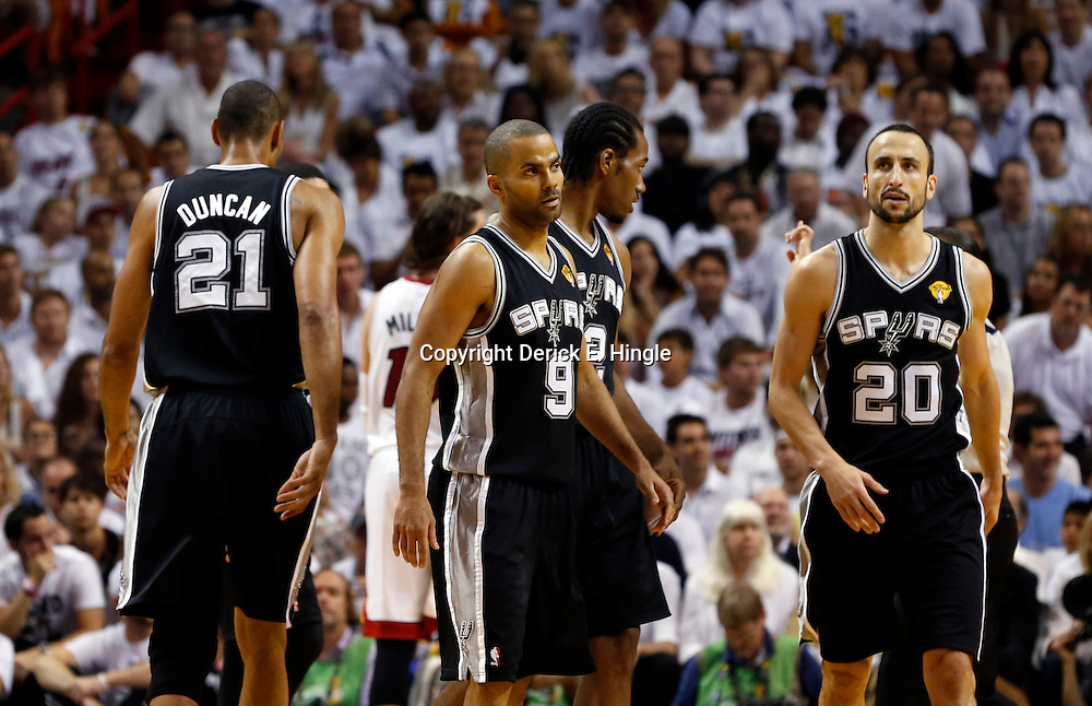 Jun 18, 2013; Miami, FL, USA; San Antonio Spurs power forward Tim Duncan (21), point guard Tony Parker (9), and shooting guard Manu Ginobili (20) on the court during the first quarter of game six in the 2013 NBA Finals against the Miami Heat at American Airlines Arena.  Mandatory Credit: Derick E. Hingle-USA TODAY Sports