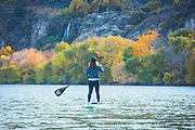 Woman Stand Up Paddle Boarding on the Snake River in Twin Falls, Idaho.