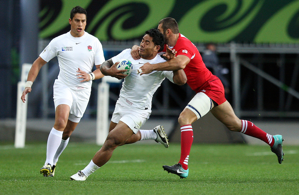 England's Manu Tuilagi, left, in the tackle of Georgia's Tedo Zibzibadze in the Rugby World Cup pool match at Otago Stadium, Dunedin, New Zealand, Sunday, September 18, 2011. Credit:SNPA / Dianne Manson.