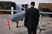 "Guest inspects the Watchkeeper UAV drone of Aerospace manufacturer Thales hospitality chalet at the Farnborough Airshow. The MoD's newest and most sophisticated surveillance and targeting drone, the Watchkeeper, is undergoing trials at Aberporth in west Wales. While the arguments over America's policy of ""assassination by drone"" rage across Pakistan and Afghanistan, fuelling public concern over the cold-eyed automation of warfare, the future of UAVs is quietly taking shape here on the Welsh coast, where there is daily proof that UAVs and manned aircraft can co-exist in British airspace."