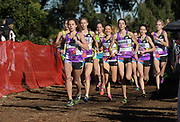 Dec 8, 2018; Balboa Park, CA, USA; Katelynne Hart, Ericka VanderLende and Alex Morris lead the girls race during the 40th Foot Locker cross country championships at Morley Field.