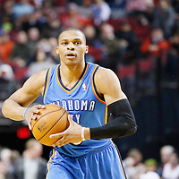 04 December 2013: Oklahoma City Thunder point guard Russell Westbrook (0) looks to pass the ball during the Portland Trail Blazers 111-104 victory over the Oklahoma City Thunder at the Moda Center, Portland, Oregon, USA.