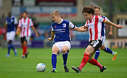Barrow's Ryan Yates shields the ball from Lincoln City's Alex Woodyard<br /> <br /> Picture: Chris Vaughan/Chris Vaughan Photography<br /> <br /> Football - Vanarama National League - Lincoln City Vs Barrow - Saturday 17th September 2016 - Sincil Bank - Lincoln<br /> <br /> Copyright © 2016 Chris Vaughan Photography. All rights reserved. Unit 11, Churchill Business Park, Bracebridge Heath, Lincoln, LN4 2FF - Telephone: 07764170783 - info@chrisvaughanphotography.co.uk - www.chrisvaughanphotography.co.uk