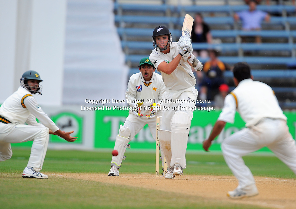 NZ batsman Tim Southee plays a shot towards bowler Abdur Rehman. 2nd cricket test match - New Zealand Black Caps v Pakistan, day four at the Basin Reserve, Wellington, New Zealand on Tuesday, 18 January 2011. Photo: Dave Lintott / photosport.co.nz