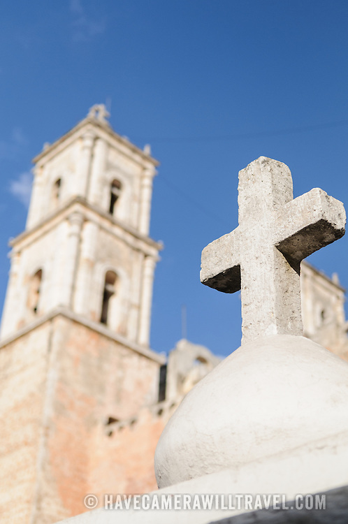 A stone cross that sits on top of one of the side gates of the Spanish colonial Cathedral of San Gervasio (Catedral De San Gervasio). This shot is taken from the side of the cathedral, looking at the back of the main steeples.