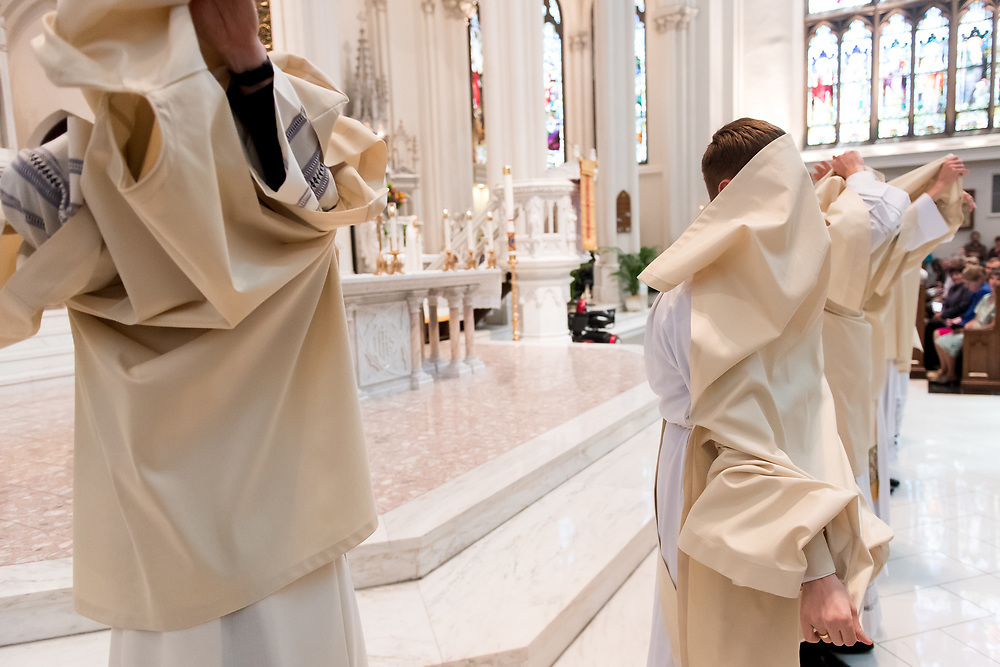 DENVER, CO - MAY 13: The ordinandi prepare to be invested with their stoles and chasubles during their ordination to the priesthood at the Cathedral Basilica of the Immaculate Conception on May 13, 2017, in Denver, Colorado. (Photo by Daniel Petty/for Denver Catholic)