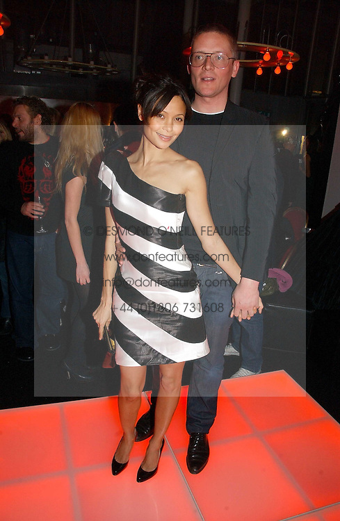 Actress THANDIE NEWTON and designer GILES DEACON at a party to celebrate the launch of a range of leather accessories designed by Giles Deacon for Mulberry held at Harvey Nichols, Knightsbridge, London on 30th October 2007.<br />