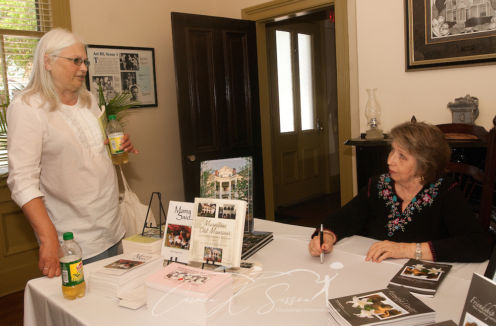 """Local author Sylvia Higginbotham (right) discusses her book, """"Friendship Cemetery: Where the Angel Wept...and Flowers Healed a Nation,"""" for Sara Evans (left) during a book signing at the Tennessee Williams Welcome Center in Columbus, Miss. April 17, 2010. (Photo by Carmen K. Sisson/Cloudybright)"""