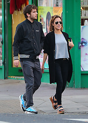 Caroline Flack and music manager boyfriend Jack Street out together in London. TV presenter supporting her new cropped hair and wearing Aviator Ray Ban shades, grey top, long black coat, black jeans and wedge shoes is recently starring in this years Strictly Come Dancing. Caroline and her toyboy boyfriend looked very much in love after a romantic meal in London. UK. <br /> BYLINE MUST READ : JAMESY/KP/GOTCHA IMAGES<br /> <br /> Copyright by © Gotcha Images Ltd. All rights reserved.<br /> Usage of this image is conditional upon the acceptance <br /> of Gotcha Images Ltd, terms and conditions available at<br /> www.gotchaimages.com