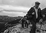With Clew Bay in the background, pilgrims slowly make their way up the mountain.