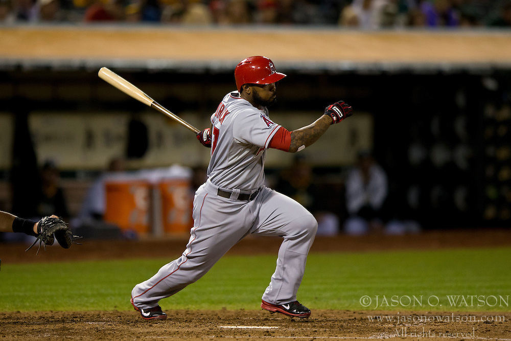 OAKLAND, CA - SEPTEMBER 23:  Howie Kendrick #47 of the Los Angeles Angels of Anaheim at bat against the Oakland Athletics during the fourth inning at O.co Coliseum on September 23, 2014 in Oakland, California. The Los Angeles Angels of Anaheim defeated the Oakland Athletics 2-0.  (Photo by Jason O. Watson/Getty Images) *** Local Caption *** Howie Kendrick