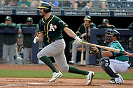 PEORIA, AZ - MARCH 05:  Adam Rosales #16 of the Oakland Athletics singles in the first inning of the spring training game against the Seattle Mariners at Peoria Stadium on March 5, 2017 in Peoria, Arizona.  (Photo by Jennifer Stewart/Getty Images)