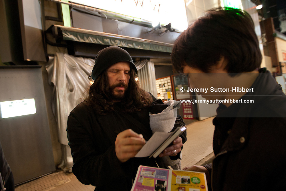 Ian Astbury, lead singer with The Cult, signs autographs for Japanese fans, after completing a pre-concert soundcheck as part of 'BXI'- a musical collaboration with Japanese band 'Boris', in the 'WWW' club in Shibuya district of Tokyo, Japan, Sunday 28th November 2010.