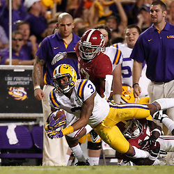 November 3, 2012; Baton Rouge, LA, USA;  LSU Tigers wide receiver Odell Beckham (3) is tackled by Alabama Crimson Tide defensive back Nick Perry (27) during a game at Tiger Stadium. Alabama defeated LSU 21-17. Mandatory Credit: Derick E. Hingle-US PRESSWIRE