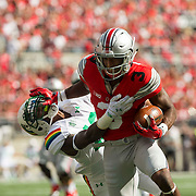 12 September 2015:  Wide receiver Michael Thomas #3 of the Ohio State Buckeyes attempts to break free from the defender during the game between the Ohio State Buckeyes and the University of Hawaii Rainbow Warriors at the Ohio Stadium in Columbus, Ohio.