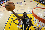 April 30, 2019; Oakland, CA, USA; Golden State Warriors forward Draymond Green (23) grabs a rebound against the Houston Rockets during the first half in game two of the second round of the 2019 NBA Playoffs at Oracle Arena. The Warriors defeated the Rockets 115-109.