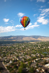 """""""Ballon Over Reno 5"""" - This hot air balloon was photographed from a balloon during the 2011 Great Reno Balloon Race. The """"toy"""" like effect was achieved using a tilt-shift lens."""